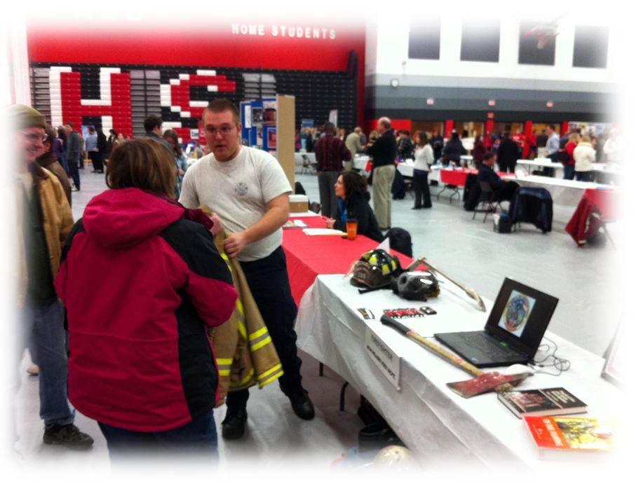 Firefighters speak to participants at a career fair