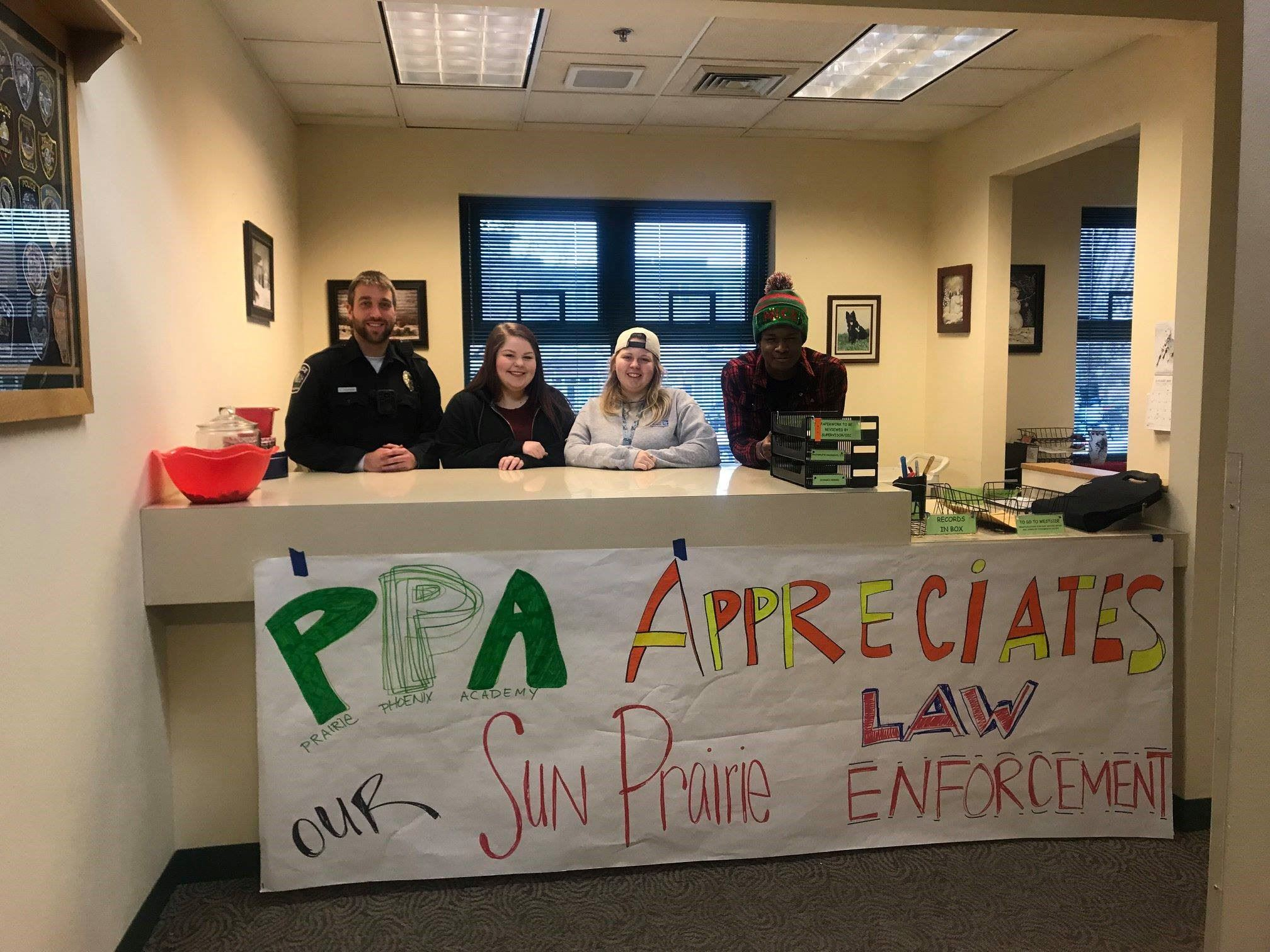 Photo of PPA students behind counter with officer